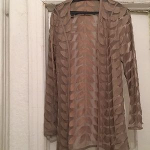 Lace cardigan with leaf design. Size fits a S/M.